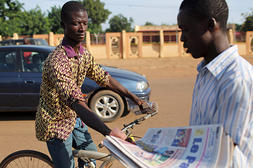 Newspapers are sold on the streets of Ouagadougou in September. News outlets silenced during the failed coup are reporting again, local journalists say. (Reuters/Joe Penney)
