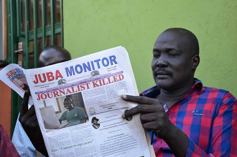 South Sudan newspaper Juba Monitor reports on the murder of Peter Julius Moi, who was shot dead in August. A series of journalist killings have put the newly independent country on the Impunity Index.  (AFP/Samir Bol)