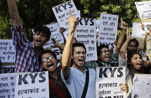 A protest in Delhi over the murder of a Muslim farmer killed over claims he slaughtered a cow. Violence over the tightening of beef laws in parts of India is having an impact on some journalists. (AP/Altaf Qadri)