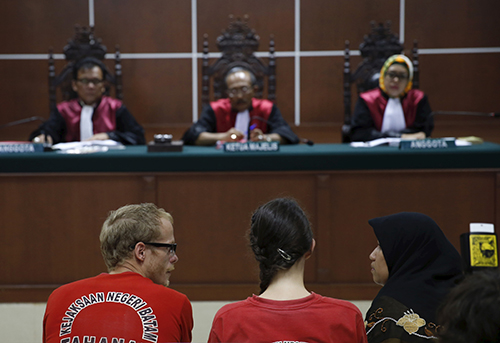 Neil Bonner and Rebecca Prosser, center, in court in Indonesia in October. The British filmmakers were sentenced for visa violations on November 3. (Reuters/Beawiharta)