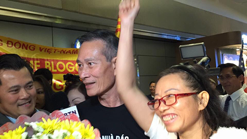 Ta Phong Tan, pictured with fellow blogger Nguyen Van Hai shortly after arriving in the U.S. After four years in a Vietnamese jail, Tan was released into forced exile. (Dieu Cay)