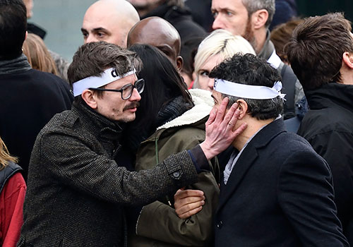 Cartoonists Renald Luzier, left, and Patrick Pelloux at a solidarity march in Paris for their colleagues killed in the attack on satirical magazine Charlie Hebdo. In 2015, 28 journalists were killed by Islamic militants. (AFP/Eric Feferberg)