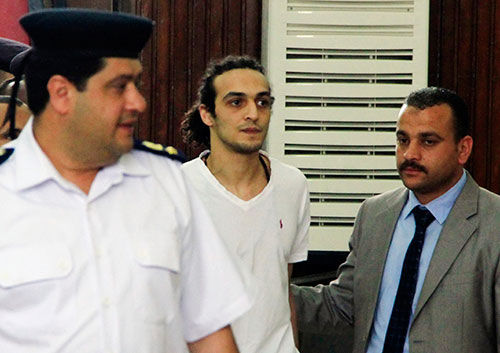 The Egyptian photojournalist known as Shawkan appears before a court in Cairo in May 2015 for the first time after more than 600 days in jail. A record number of journalists are imprisoned in Egypt in 2015. (AP/Lobna Tarek)