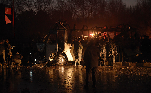 Afghan security forces examine the wreckage of a vehicle carrying Tolo TV employees in Kabul. A suicide attack on the minivan killed six staff and injured more than 25. (AFP/Shah Marai)