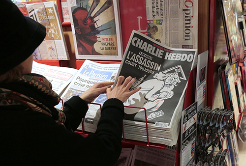 Satirical magazine Charlie Hebdo releases an anniversary edition to mark the deadly attack on its staff last January. Government responses to the killings have threatened press freedom. (Jacques Demarthon/AFP)