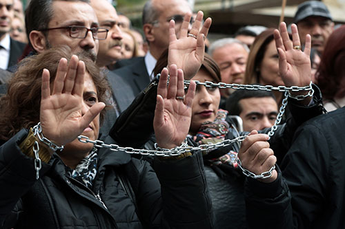 Turkish journalists protest the arrest of their colleagues Can Dündar and Erdem Gül, in Ankara, November 27, 2015 (AP/Burhan Ozbilici).