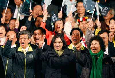 Tsai Ing-wen, center, declares victory in the presidential election in Taipei on January 16, 2016. (AP/Wally Santana)