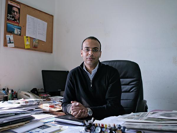 Hossam Bahgat sits at his desk in a December 7, 2011, file photo (AP/Sarah Rafea)