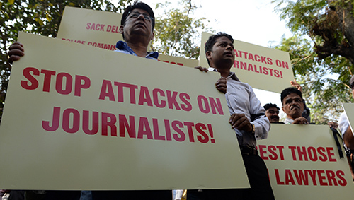 Indian journalists march in protest at attacks on colleagues outside a Delhi court. (AFP/Indranil Mukhejee)