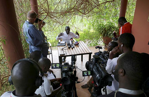 Ugandan opposition leader Kizza Besigye, who is under house arrest, speaks during a news conference at his home on the outskirts of Kampala, the capital, on February 21. (Reuters/Goran Tomasevic)