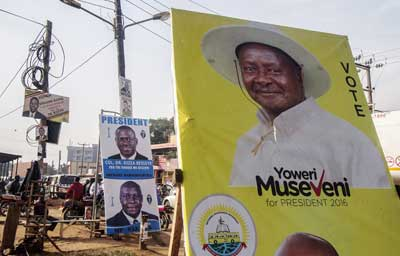 A photo taken on February 11, 2016 shows election posters of incumbent President Yoweri Museveni and opposition leader Kizza Besigye in Kampala. (Isaac Kasamani/AFP)