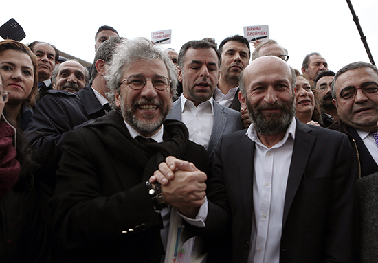 Can Dündar, left, and Erdem Gül speak to reporters before standing trial in Istanbul, March 25, 2016. (AP)