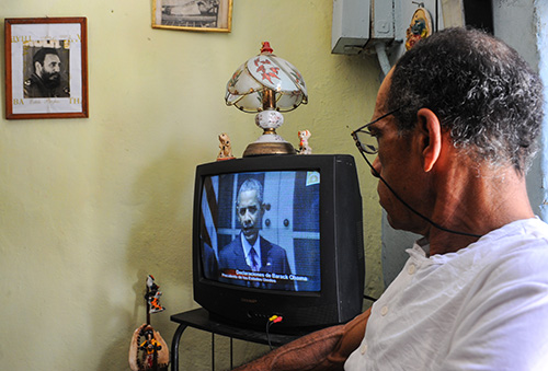 A Cuban watches Barack Obama give a speech about resuming diplomatic ties with Cuba. The U.S. President is due to visit the island-nation in March. (AFP/Yamil Lage)