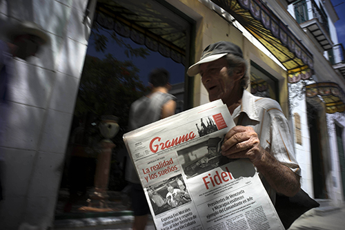 Copies of the state-run newspaper Granma are sold on the streets on Havana. Cuba does not allow privately owned media outlets but bloggers say they are increasingly able to report independently. (AP/Ramon Espinosa)