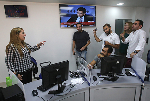 Karma Khayat, pictured left in Al-Jadeed's newsroom. A conviction against her by the Special Tribunal of Lebanon has been overturned. (AP/Hussein Malla)