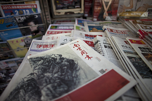 Copies of the altered 2013 edition of Southern Weekly. Weibo posts about protests over the changed editorial were censored. (AP Photo/Alexander F. Yuan)