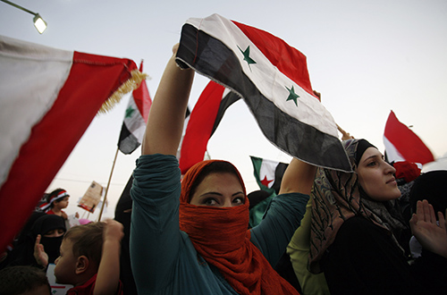 Syrians protest the killing and torture of women by President Assad's regime in 2011. The blogger Tal al-Mallohi remains in jail in Syria despite a court ordering her release. (AP/Mohammad Hannon)