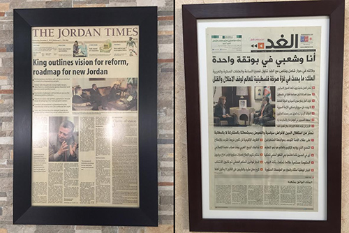 A composite of framed front pages featuring King Abdullah II promising reform hang on the walls of Jordanian newspapers, Jordan Times, left, and Al-Ghad, right. Jumana Ghumainat, of Al-Ghad, says the king's support for her paper has been important. (CPJ/Jason Stern)