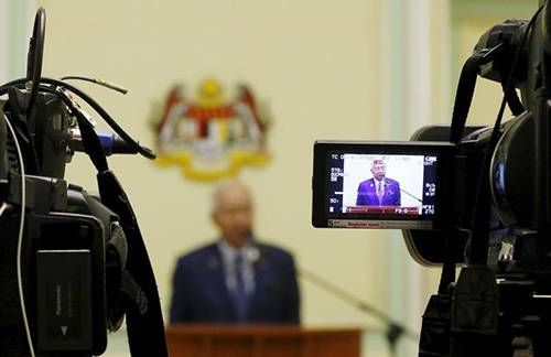 Malaysia's Prime Minister Najib Razak speaks to the press in September 2015. News outlets that critically covered allegations in the 1MDB scandal are facing censorship and pressure. (Reuters/Olivia Harris)