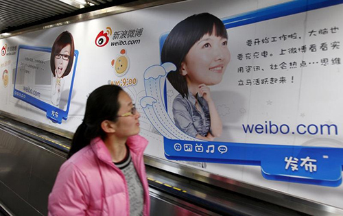 An advertisement for Weibo in Beijing. The Chinese microblogging site uses a large team of censors to monitor users' posts, a former employee says. (Reuters/China Daily)