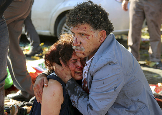 A man and woman embrace after a bomb exploded in Ankara, October 15, 2015 (Reuters).