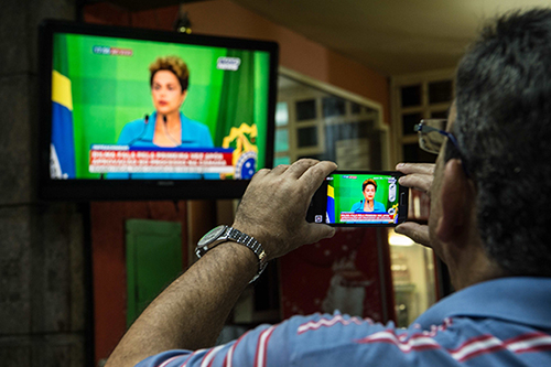 A cell phone records President Dilma Rousseff as she reacts to the impeachment vote. Amid Brazil's political crisis, a cybercrime bill with troubling implications for press freedom is being proposed. (AFP/Christophe Simon)