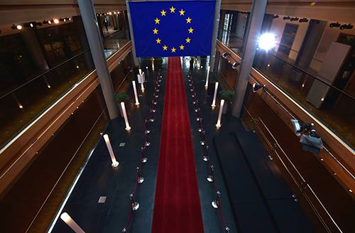 The EU flag hangs in the European Parliament in Strasbourg. A series of votes on legislation could impact journalists in member states. (AFP/Patrick Hertzog)