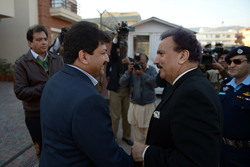 Hamid Mir, pictured with Pakistani Interior Minister Rehman Malik in 2012 after a bomb was found under the journalist's car, says he takes threats seriously. The Geo News anchor has also survived two shootings. (AFP/Farooq Naeem)