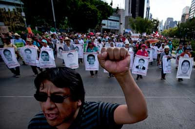 Violence has spiked in Guerrero state, where Francisco Pacheco Beltrán was killed. Pictured, relatives protest the disappearance of 43 students in the state in 2014. (AP/Marco Ugarte)