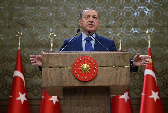 Turkish President Recep Tayyip Erdoğan addresses local officials at his palace in Ankara on March 20, 2016. Erdoğan said Russian and U.S. arms were finding their way to Kurdish groups Turkey classes as terrorist organizations. (Murat Cetinmuhurdar/Pool/AP)