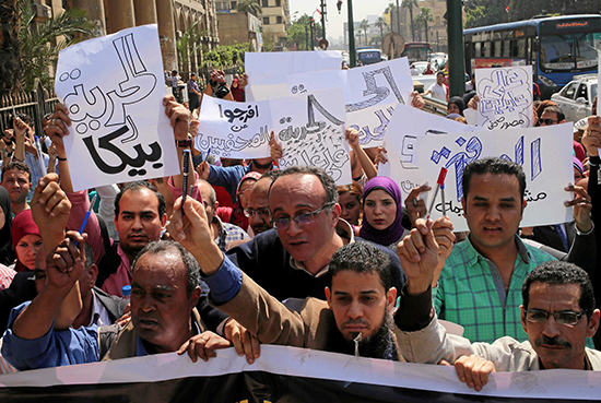 Egyptian journalists protest the arrest of their colleagues at the General Prosecutor's office in central Cairo, April 28, 2016 (Mohammed Abdel Ghany/Reuters)