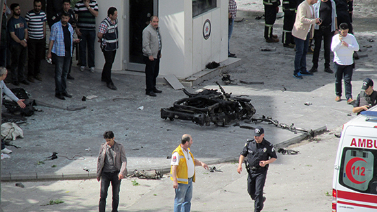 Security officials investigate the scene of a bombing in front of a police station in Gaziantep, Turkey, May 1, 2016. Police detained Mehmet Hakkı Yılmaz, the first reporter at the scene, after he filed his story, his employer said. (IHA/AP)