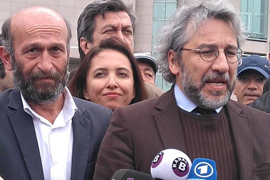 Can Dündar (right), editor of Cumhuriyet newspaper, and Ankara Bureau Chief Erdem Gül, speak to reporters before their May 6, 2016, sentencing hearing in Istanbul. (Özgür Öğret)