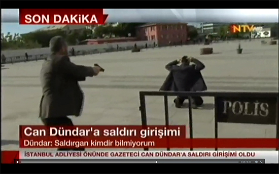 A screenshot from an online video feed of Turkey's NTV television station shows police detaining the man suspected of attempting to shoot Cumhuriyet journalist Can Dündar outside his trial in Istanbul, May 6, 2016.