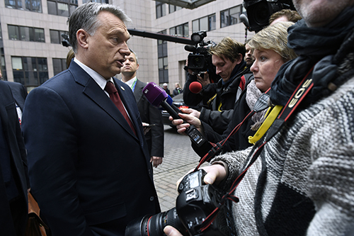 Hungary's Prime Minister, Viktor Orbán, talks to the press outside the EU leaders' summit in March. The country's poor press freedom record and policies on asylum seekers have been criticized by the U.N. (AFP/John Thys)