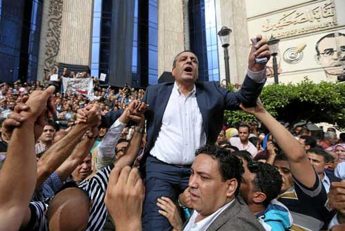 Journalists carry Yehia Qallash, head of the Egyptian Journalists Syndicate, at a protest against restrictions on the press in Cairo on May 4. (Reuters)