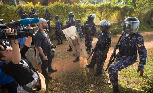 In this February 22, 2016, photo, riot police prevent the media from approaching Uganda's main opposition leader Kizza Besigye as he tries to leave his house in Kasangati, Uganda. (AP/Ben Curtis)