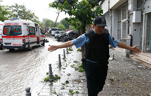 A policeman gestures after a bomb exploded in central Istanbul, killing at least 11 people, June 7, 2016 (Osman Orsal/Reuters)