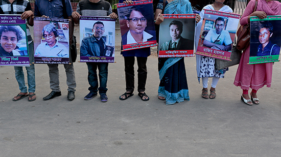 Demonstrators hold pictures of those killed by violent extremists in Dhaka, June 15, 2016. (AP)