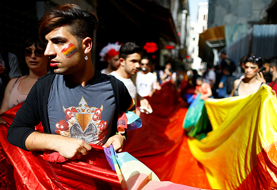 "Activists hold a rainbow flag at a banned ""Trans Pride"" rally in central Istanbul, June 19, 2016. Police used tear gas and water cannons to disperse marchers and detained journalists trying to cover the event, according to press accounts. (Osman Orsal/Reuters)"