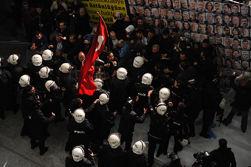 Riot police swarm the Istanbul offices of Turkish papers Zaman and Today's Zaman in March, after a court ruled that new trustees should take over the publications. (AFP/Akif Talha Sertturk, Zaman Daily Newspaper)