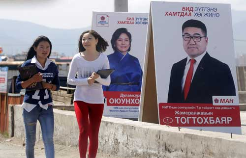 Women walk past posters of candidates from the Mongolian People's Party on the outskirts of the capital, Ulaanbaatar, on June 27, 2016. The election on June 29 is unlikely to have a strong impact on press freedom in Mongolia. (Reuters/Jason Lee)