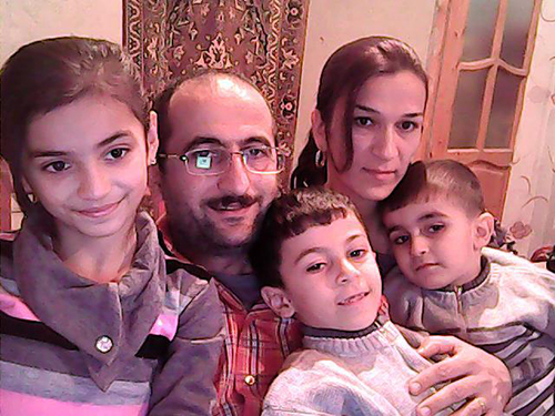 Idrak Abbasov with his family. The journalist says his children were confused when they first went into exile, but that they are starting to settle into their new life in Norway. (Idrak Abbasov)
