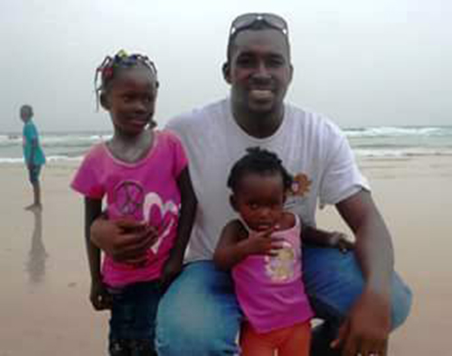 Sanna Camara, pictured with his children, says he struggled to support his family in exile. (Sanna Camara)