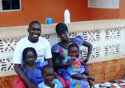 Sanna Camara, pictured with his wife and children. The reporter says when he calls home, his daughter asks when he is coming home. (Sanna Camara)