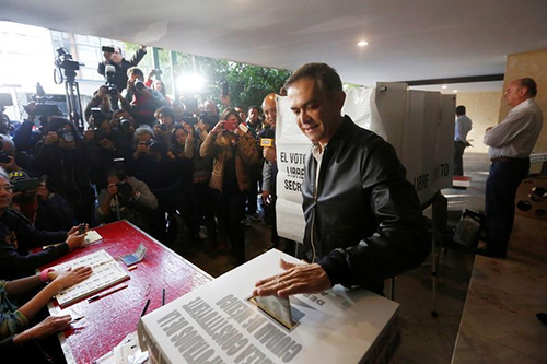 Miguel Angel Mancera, the mayor of Mexico City, casts his vote on June 5. Journalists were threatened and harassed in the lead up to state elections. (Reuters/Edgard Garrido)