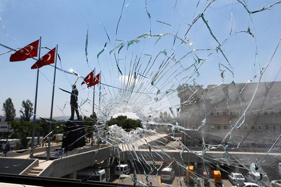 Turkey's capital is calm as seen through a broken window at Ankara police headquarters, July 18, 2016, days after soldiers launched a failed attempt at a coup. (Osman Orsal/Reuters)
