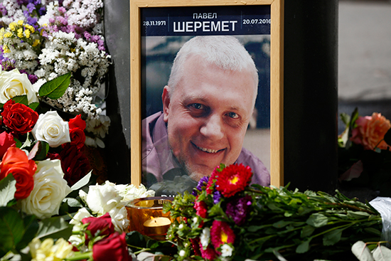 Flowers and a portrait of Pavel Sheremet mark the site of the journalist's murder in Kiev, July 20, 2016. (Sergei Chusavkov/AP)