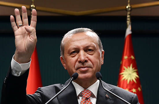 In this July 24, 2016, handout photo, Turkish President Recep Tayyip Erdoğan gives the Rabaa salute, a reference to Cairo's Rabaa al-Adawaya Square, where Egyptian soldiers and police in August 2013 killed hundreds of supporters of Egyptian President Mohammed Morsi protesting the military's ousting of the Egyptian president in July 2013. (Pool/AP)