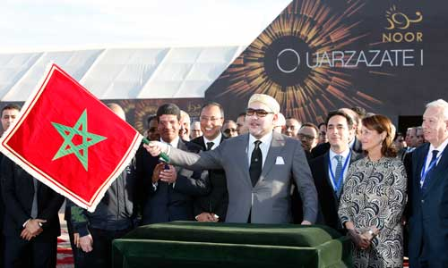 King Mohammed VI waves a Moroccan flag as he inaugurates a solar plant in Ouarzazate, central Morocco, on February 4, 2016. The king and national symbols like the flag are sensitive subjects for the media. (AP/Abdeljalil Bounhar)
